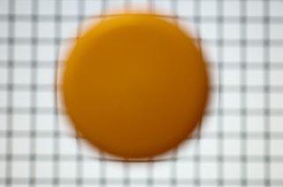 Photo 2: Yellow plastic cap in front of screen, focus between cap and screen